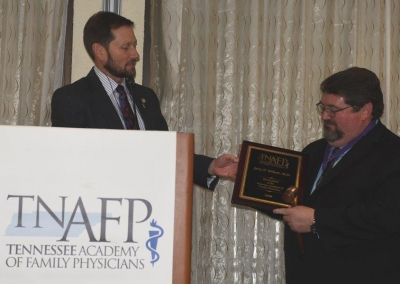Doctor Webb presenting President's Plaque and Gavel to Doctor Wilson put with President's Corner
